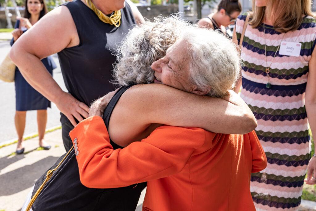 Linda hugging friend