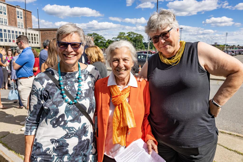 Linda posing with friends at June 23rd building dedication